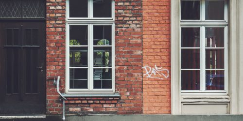 A picture of houses with graffiti