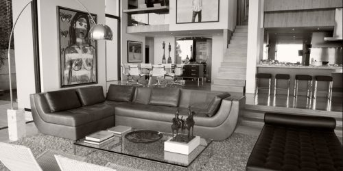 black and white photograph of modern living area interior
