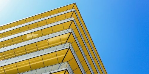 Bright yellow building in London with blue sky